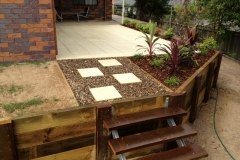 Timber retaining wall, paved courtyard